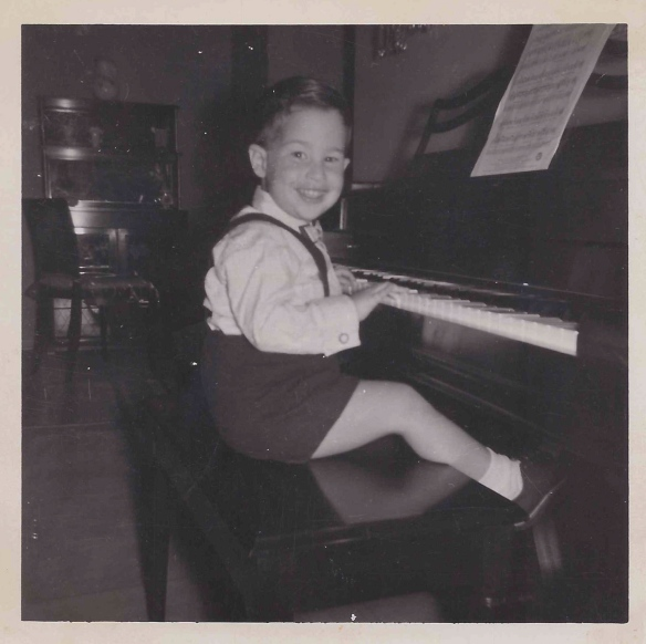 John at the piano, a few years before beginning lessons.