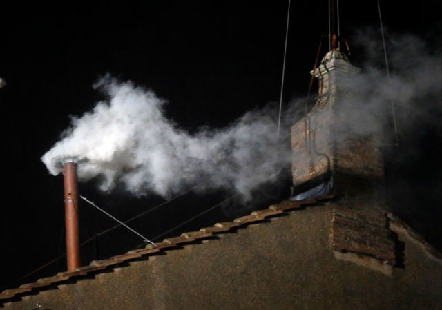 White smoke emerges from the chimney on the roof of the Sistine Chapel, in St. Peter's Square at the Vatican, Wednesday, March 13, 2013. indicating that the new pope has been elected. (AP Photo/Gregorio Borgia)