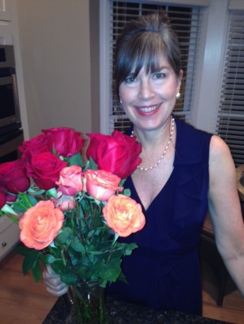 Karen Paul Holmes with roses